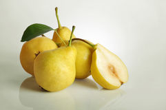 Fresh pears. Rip fresh pears on light background Stock Photos
