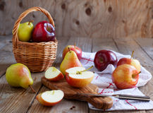 Fresh pears and apples on wooden table. Selective focus Stock Image
