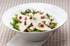 Fresh pears arugula gorgonzola cheese salad Royalty Free Stock Photography
