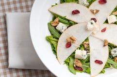 Fresh pears arugula gorgonzola cheese salad Stock Image