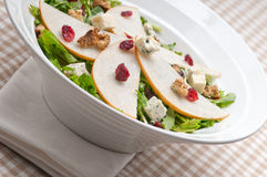 Fresh pears arugula gorgonzola cheese salad Royalty Free Stock Image