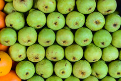 Fresh pears being sold in fruit market Stock Image