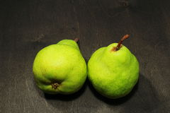 Fresh pears in black wooden background. Fresh green pears in black wooden background stock images