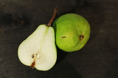 Fresh pears in black wooden background. Fresh green pears in black wooden background royalty free stock photo