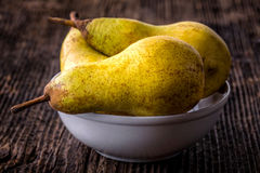 fresh pears in a bowl on old  table Stock Images