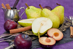 Fresh pears and cinnamon Stock Photos