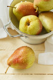 Fresh pears in a colander Royalty Free Stock Photography