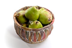 Fresh pears in a colorful basket Royalty Free Stock Photos