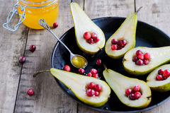 Fresh pears with cranberries and honey Royalty Free Stock Photography