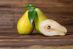 Fresh pears. With leaves in a basket on wooden background Royalty Free Stock Photo