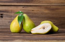 Fresh pears. With leaves in a basket on wooden background Stock Photography