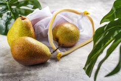 Free Fresh Pears In A Mesh Bag Stock Image - 149877761