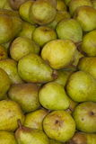 Fresh pears. Large box of fresh ripe green pears on a market stall Stock Photo