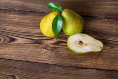 Fresh pears. With leaves in a basket on wooden background Royalty Free Stock Image