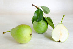 Fresh pears with leaves on a light background. Still life with pears Stock Photography