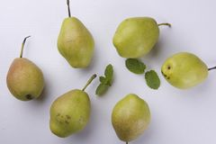 Fresh pears with mint leaves Stock Photos