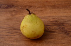 Fresh pears on old wooden table Stock Images