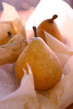 Fresh pears on paper Royalty Free Stock Photography