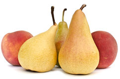 Fresh pears and peaches. Fresh homegrown pears and peaches on white background Royalty Free Stock Photo