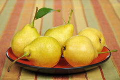 Fresh pears on plate Stock Photo