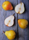 Fresh pears. In plate on the wooden table Stock Photos