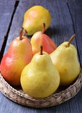 Fresh pears. In plate on the wooden table Stock Photo