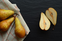 Fresh pears on a stone table Stock Photo