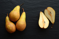 Fresh pears on a stone table Royalty Free Stock Image
