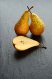 Fresh pears on a stone table Stock Photography