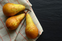 Fresh pears on a stone table Royalty Free Stock Photo