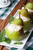 Fresh pears stuffed with cottage cheese vertical Royalty Free Stock Photo