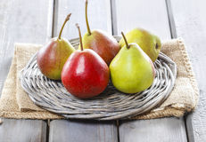 Fresh pears on wicker tray Stock Image