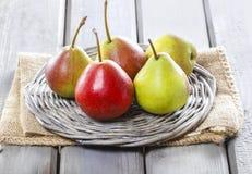 Fresh pears on wicker tray Stock Image