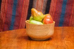 Pears in Bowl with Striped Background Royalty Free Stock Photography