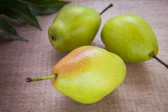 Fresh pears on wooden background Stock Images