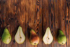 Fresh pears on the wooden background Stock Photography