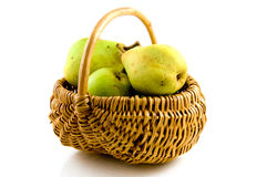 Fresh pears in wooden basket Royalty Free Stock Photography