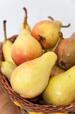 Fresh pears in the wooden basket Royalty Free Stock Image
