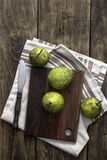 Fresh pears on wooden cutting board Royalty Free Stock Images