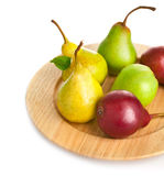 Fresh pears on the wooden plate Stock Photography