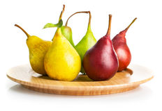 Fresh pears on the wooden plate Stock Photos