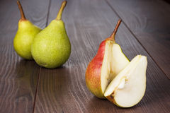 Fresh pears on wooden table. Some fresh pears on the wooden table stock photography