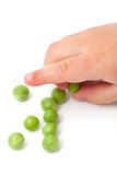 Fresh peas and child's hand Royalty Free Stock Image