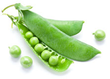 Fresh peas are contained within a pod. Royalty Free Stock Photography