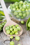 Fresh Peas on a cooking spoon Stock Image