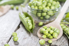 Fresh Peas on a cooking spoon Stock Photo
