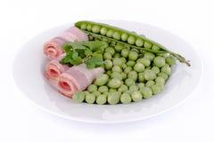 Fresh peas and ham rolls. Stock Images