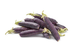 Fresh peas in purple pod. On white background Royalty Free Stock Photography