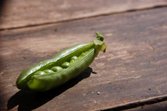 Fresh peas on wooden farm table Royalty Free Stock Images