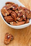 Fresh Pecan nuts. In a white bowl Royalty Free Stock Photos